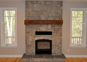 A stunning stone fireplace with