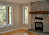 Large windows, a stone fireplace